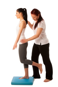 Physiotherapy - therapist doing   excercises for improving coordination
